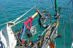 Bike on sailboat bow Bahamas © Ann DeMuth